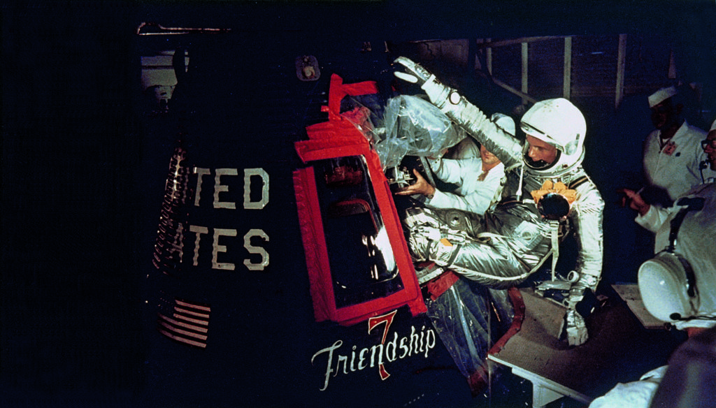 Overall view of astronaut John Glenn, Jr., as he enters into the spacecraft Friendship 7 prior to MA-6 launch operations at Launch Complex 14. Astronaut Glenn is entering his spacecraft to begin the first American manned Earth orbital mission.